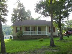 Country Setting on a Corner Lot! Split floor plan, 3 bedrooms, 2 baths, large master suite, open family room and kitchen, separate laundry room, bonus room adds additional square footage with wood burning stove in Savannah TN