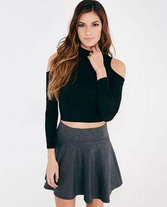 <p>A trendy crop top featuring a super soft ribbed knit fabric, a cold-shoulder design, a mock neckline, and a snug cropped fit.</p>  <p>Model wears a size small.</p>  <ul> <li>Mock Neckline</li> <li>Long Sleeves</li> <li>Unlined</li> <li>Rayon / Polyester / Spandex</li> <li>Hand Wash</li> <li>USA</li> </ul>