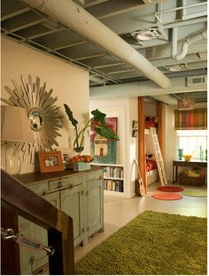 basement makeover w/o adding a ceiling.  Just use paint.