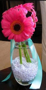 Pretty Pearl Baby Shower Ideas! Pearls in mason jars to hold silverware | OHMY-CREATIVE.COM | Baby Shower Themes | Mason Jars | Centerpiece | Pearls | String of Pearls | Pink and Teal Shower | Gerbera Daisy
