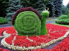 Not even moving at a snail's pace! #Topiary #gardensculpture #garden
