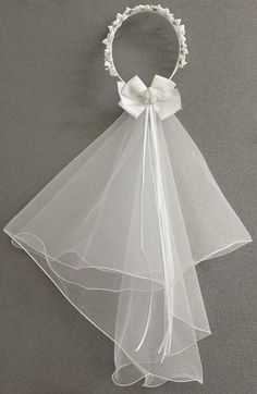 Free shipping and returns on Sorbet Communion Wreath with Removable Veil (Girls) at Nordstrom.com. Add an angelic touch to her special-day attire with this beautiful hair wreath accented with ribbon rosettes and pearly beads. A grosgrain bow, trailing ribbons and a detachable layered-tulle veil complete the elegant headpiece.