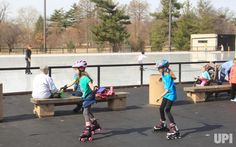 Young girls choose to roller blade past the few ice skating at Steinberg Rink at Forest Park in St. Louis on February 20, 2017.…