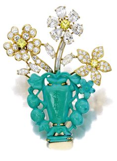 A colored diamond, diamond and turquoise brooch, Ruser designed as a carved turquoise planter, extending vari-cut diamond and colored diamond flowers; signed Ruser; estimated total diamond weight: 4.55 carats; mounted in eighteen karat gold plated platinum; length: 2in.