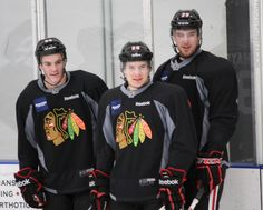 Ice hog players Shaw, Smith, and Hayes