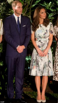 The Royal couple listen to speeches at the reception where they toast with a glass of water at the Eden Hall in Singapore