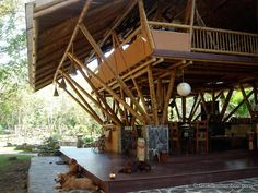 This beautiful Guadua bamboo house in Costa Rica, is located near Playa Sombrero at the Osa Peninsula. The bamboo house was designed and built by Costa Rican architect Mariela Garcia and her husband Steve Jurries. Bamboo House Design, Small House Interior Design, Bamboo Architecture, Sustainable Architecture, Vernacular Architecture, Architecture Design, Home Building Design, Building A House, Houses In Costa Rica