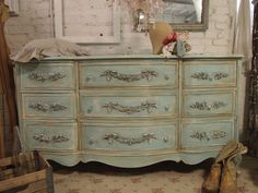 must add the floral embellishments to common garage sale dresser before painting it...for samantha?  for me?