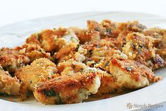 Parmesan Chicken Recipe, one of the most loved recipes on SimplyRecipes.com. Chicken pieces dipped in butter, breaded with Parmesan, and baked until crispy and brown.