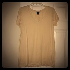 Cream short sleeve oversized tee with drawstring Cream colored oversized boxy tee with drawstring at bottom. Pleats in back. V neck front. Victoria's Secret Tops Tees - Short Sleeve