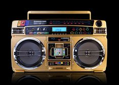 A limited edition of the successor to the TRC-931 boombox, the I931X Gold has an iPod dock, USB, SSD/MMC, auxiliary and headphone/microphone inputs, AM/FM radio and alarm clock.