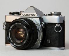 Olympus https://www.etsy.com/listing/150904914/olympus-om-f-om-30-vintage-camera-slr?ref=shop_home_active