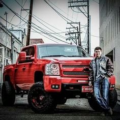 nice lifted red Chevrolet truck forget the boy! Chevy Duramax, Silverado Truck, Lifted Chevy, Chevrolet Trucks, Chevrolet Silverado, Truck Senior Pictures, Photography Senior Pictures, Fall Photography, Senior Photos
