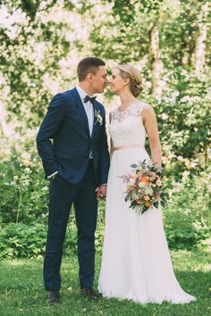 Real wedding in Finland. Dress made by Pukuni (www.pukuni.fi). Wedding dress with lace, chiffon and open back.