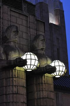 The iconic stone men at the front entrance of Helsinki Central Station are a symbol of Helsinki.