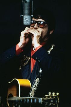 Roy Orbison, the great songwriter with the distinct high barytone voice, who in the latter years of his career became the ghostly white clown of rock, hiding behind his tainted prescription glasses, was born April 23, 1936. He died of a massive heart attack in 1988, when thanks to The Traveling Wilburys, he was enjoying a resurgence in his career… (via rocknrolltina)