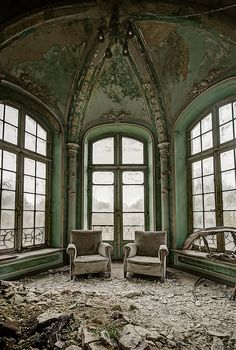 Comfort in decay. Comfy chairs in abandoned chateau Belgium