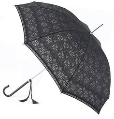 This lovely black parasol / umbrella has a distinctive floral pattern and is trimmed in black lace. This is a classic vintage design and has a matching black faux leather handle with tassels. Elegant, ultra-slim fibreglass frame. Length of 35 inches and an open canopy of approximately 37 inches. $45.00