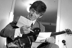 George relaxing with some fan mail and a cigarette backstage before a show in Margate in July 1963.