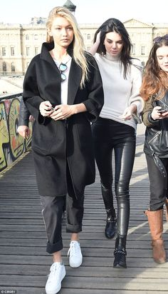 Down day: Gigi Hadid and Kendall Jenner took some time off from the catwalks to take a trip to Pont des Arts bridge in Paris