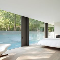 Bedrooms on the semi-below ground floor overlook the pool which spatially appears to extend the bedrooms viewed from this level.