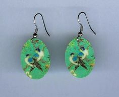 Blue Birds Earrings by design mosaic. A pair of blue birds perch together on a green background. Made from polymer clay with surgical steel ear wires. Antique Japanese decorative image. #handmade #jewelry