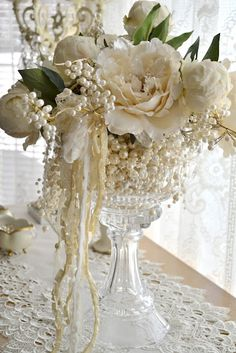 centerpiece with pearls. I like the idea of filling vases with pearls