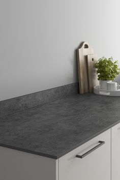 Looking for marble countertops ideas? Our Blackened Steel Effect Compact Laminate Worktop looks amazing when paired with a dove grey slab kitchen and black kitchen hardware. These blackened steel effect kitchen countertops are affordable and are perfect for creating your a waterfall worktop for a modern kitchen design. Laminate Installation, Kitchen Worktops, Kitchen Hardware, Dove Grey, Work Surface, Work Tops, Marble Countertops, Black Kitchens, Modern Kitchen Design
