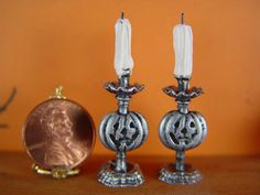 This listing is for a pair of Jack O Lantern Candle sticks with fancy Victorian metal candle holders. They are for 1:12th Scale and stand