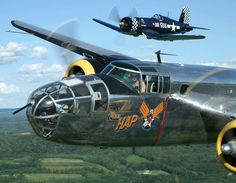 """B25 Mitchell Bomber """"Hap"""", Tail #82168 and a corsair fighter escort."""