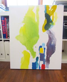 I wonder if I could use this technique - pouring paint mixed with water onto canvas - to make some art for the living room...