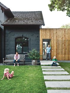 inspiration for my house - Traditional home painted black with addition clad in wood with slit windows.