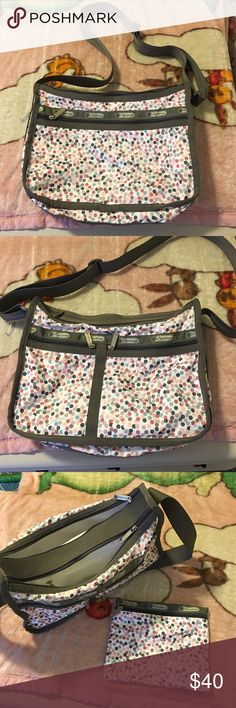 Large Polka Dot LeSportSac bag Very good condition LeSportSac bag. Has 3 outside side pockets and 2 large compartments with 1 interior pocket in one. Adjustable strap. Expandable side to put more stuff in. Comes with a small pouch. 13.5x9 inches. Was my mom's so it's was super well kept. Smoke free, pet friendly. Any questions, please ask. LeSportsac Bags