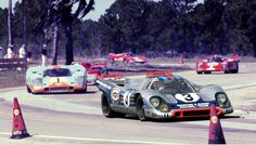 At Sebring in 1971 the winning Martini & Rossi Porsche 917K of Vic Elford and Gerard Larrousse leads the Jo Siffert/Derek Bell Gulf 917 followed by the Nanni Galli/Rolf Stommelen T33/3 Alfa.