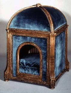 A niche de chien for the the Queen's dog to keep snug and warm on a cold rainy day. It was made by Claude Sené.