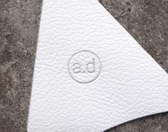 a.d. hand stamp on textured white leather - Handmade in England
