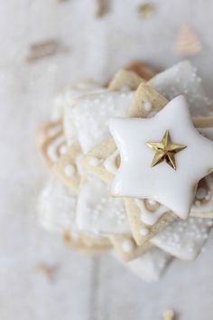 Beautiful star shaped sugar cookies with gold star decorations.