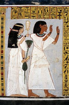Roy with his wife Tawy Egypt ~ Roy is in an worshipful stance. Tawy is playing the sistrum and is holding the lotus of rebirth and regeneration.