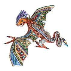 Fantastic dragon by artist Manuel Cruz. Manuel Cruz is a greatly talented woodcarver from Oaxaca. He has developed a style of his own, creating wonderful figures very nicely painted. This fabulous dragon is so well carved... the spread out wings and curving tail are magnificent!