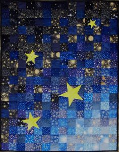 This reminds me of the quilt I made my son, yet this is much prettier.  glaxy with 2 1/2 inch strips and many stars Sampaguita Quilts