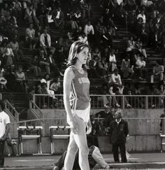 Black and white photo of University of Oregon high jumper Kari Easton ready to begin her approach during a meet held at Hayward Field in 1982. ©University of Oregon Libraries - Special Collections and University Archives
