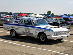 1964 Max Wedge Plymouth. Gotta have one to race and one to cruise. Post cars like this are made for 1320 ft.