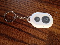 Let me take a selfie keychain - Hit - hold your camera out and push the button on your key chain to take the perfect selfie. Bluetooth sync