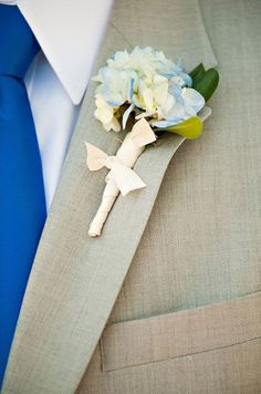 A blue hydrangea bloom makes for a stylish boutonniere.