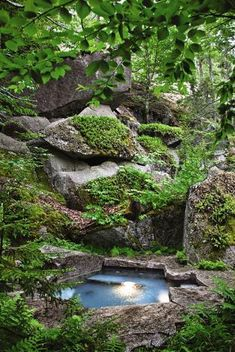 "Richardson continued his seamless blending of nature and design with a ""natural spring"" spa. To preserve the area's unity with the surrounding hillside, during construction Richardson wrapped the lichens and moss coating the boulders in burlap and kept them moist to protect and sustain them."