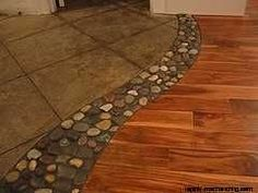 tile and wood flooring with river rock between