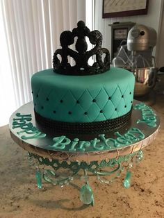 Teal and black crown cake