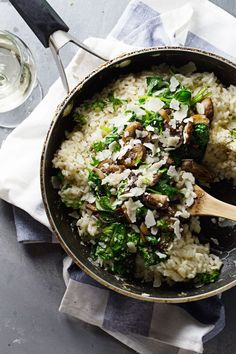 Garlic Butter Mushroom Risotto - super simple! white wine, garlic, mushrooms, butter, spinach, and creamy risotto. 370 calories. | pinchofyum.com #vegetarian #recipe #mushroom #risotto