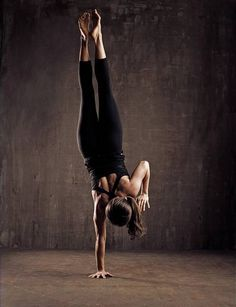 One-armed handstands yoga pose.