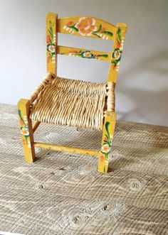 Mexican style childrens chair - vintage  Mexican Folk art style chair for child - prop - doll - stuffed animal - boho home decor - stand for towels riser - shabby folk art accent Woven rush seat - with yellow painted wood & flower design Charming little chair can be used in any number of ways. In good vintage condition with light wear from use and age. No major issues  Measures 15 7/8 high Seat base is 10 1/4 across Link to guttersnipes.etsy.com for vintage home decor, housewares Link to…